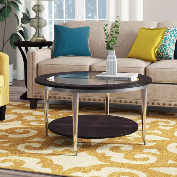 Lefker Wheel Coffee Table With Storage By Orren Ellis