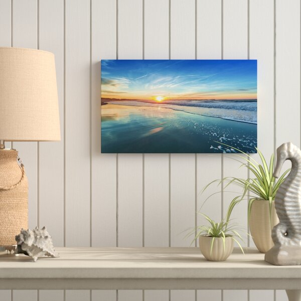 Seashore With Distant Sunset Photographic Print On Wrapped Canvas In Blue By Highland Dunes.