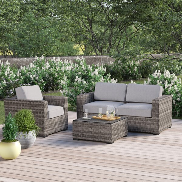 Deandra 4 Piece Ratttan Sofa Seating Group with Cushions by Sol 72 Outdoor