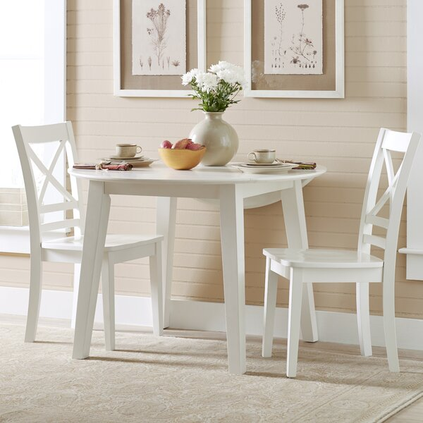 Newbury Wooden Round Dining Table by Highland Dunes