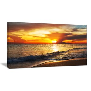 Colorful Dramatic Sunset Over Waves Modern Beach Photographic Print on Wrapped Canvas by Design Art