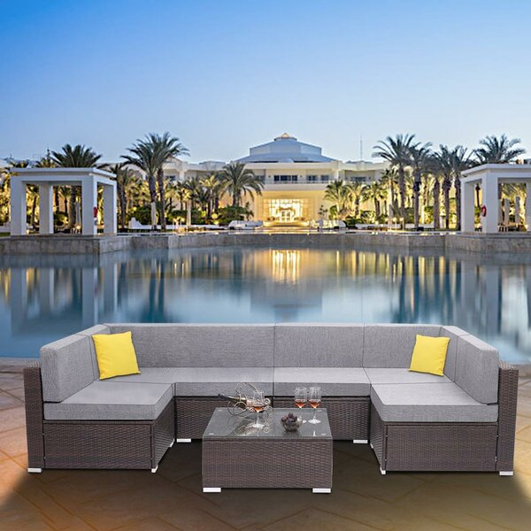 Anartz 7 Piece Rattan Sectional Seating Group with Cushions by Latitude Run
