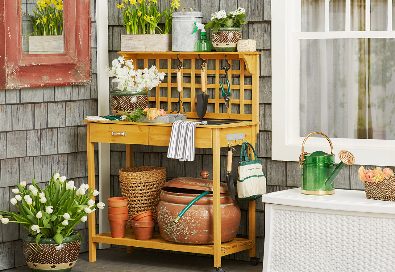 potting table with pots and potting tools