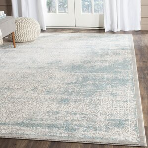 Dionne Turquoise/Ivory Area Rug