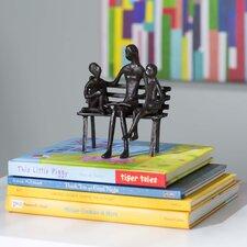 Mother Reading to Children Sculpture